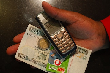 Mobile Phone with Money in Kenya by whiteafrican (cc) (from Flickr)